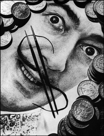 Savador Dalí, bearing a $ moustache; it is said that Breton's accusations